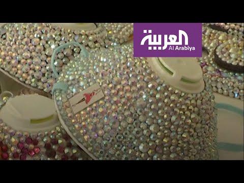 أردنية تصنع كمامة على الموضة مزينة بالأحجار اللامعة