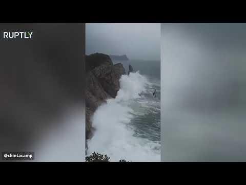 شاهد المشي على حبل فوق البحر أثناء إعصار هايشن