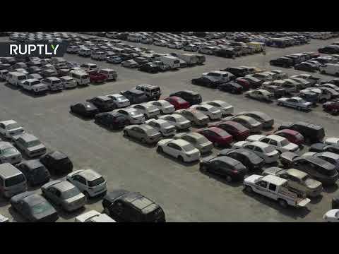 شاهد مئات السيارات الفارهة تنتظر ملاكها الجدد في دبي