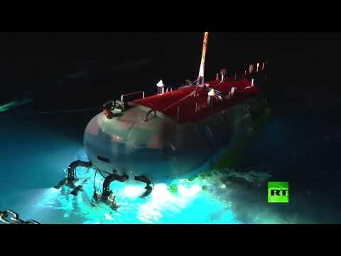 شاهد الغواصة الصينية الكفاح حطم رقمًا قياسيًا في الغوص إلى أعمق نقطة في الكوكب